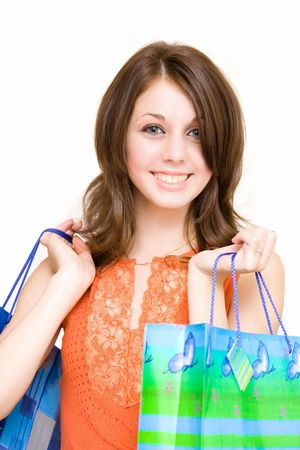 Young woman with bags shopping for  photo