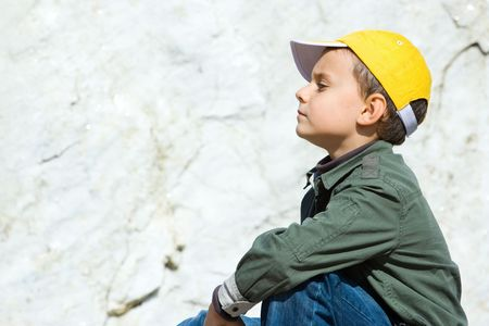 Portrait of a cute boy with a big marble stone in the background Stock Photo - 3683278