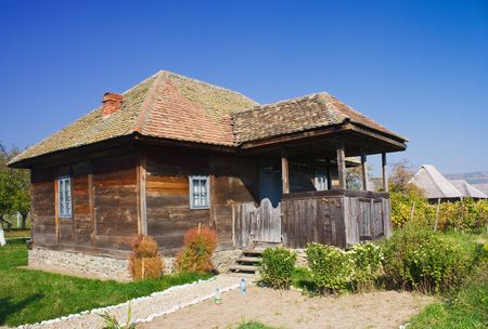 An old house made of wood from Romania photo