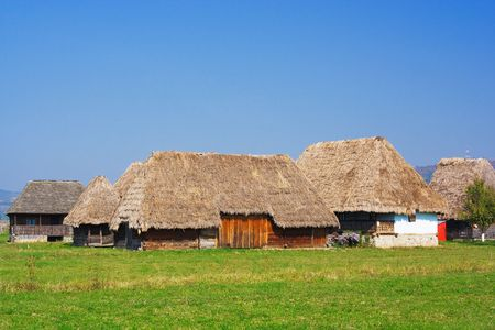 Old houses with roof of thatch photo