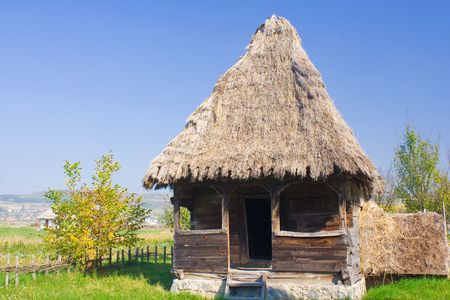 An old hous with roof of thatch photo
