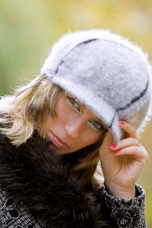 Portrait of a beautiful woman with hat outdoor photo