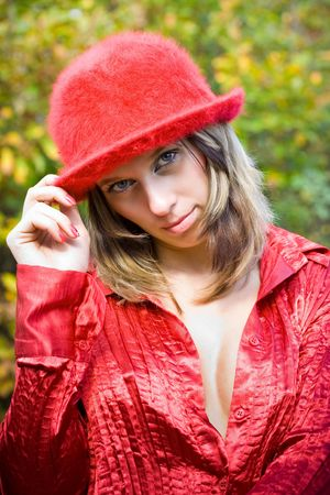 Beautiful sexy woman with red hat outdoors photo