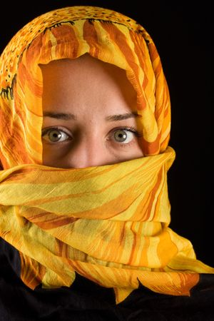 veiled: close-up portrait of a beautiful woman wearing veil