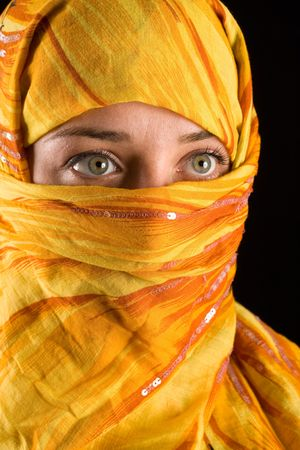 women face stare: close-up portrait of a beautiful woman wearing veil