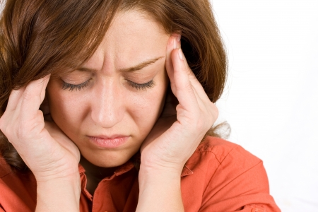 health issue: Portrait of a woman with severe headache Stock Photo