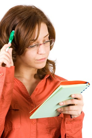 Young business woman writing a note photo
