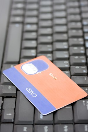 A credit card on a desktop computer keyboard Stock Photo - 4018779