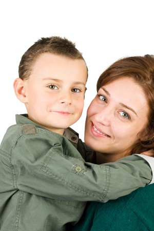Mother holding her cute seven year old son, isolated on white photo