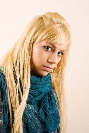 Close up portrait of an attractive blonde girl with blue scarf photo