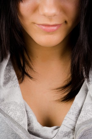 Lower half face and chest of a beautiful brunette photo