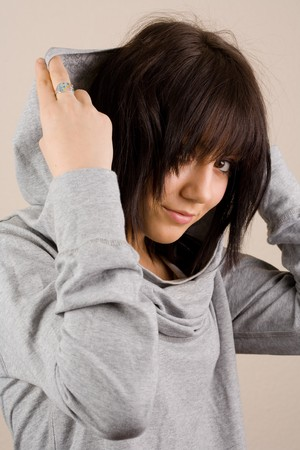 Portrait of a beautiful brunette with sweater and hood photo