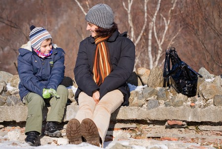 Mother and son having good time together outdoors photo