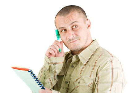 Young casual businessman writing in a notebook Stock Photo - 4173725