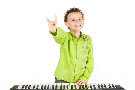synthesizer: Cute little boy playing synthesizer or piano, isolated on white background