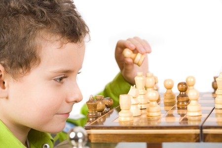8 years old cute kid playing chess photo