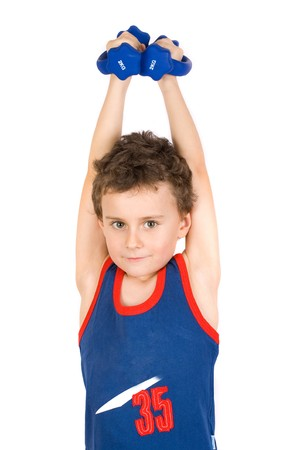 8 years old boy doing fitness Stock Photo