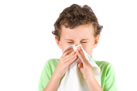 sneeze: Close-up portrait of a child wiping his nose