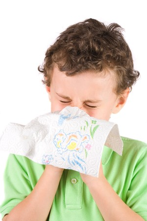 Close-up portrait of a child wiping his nose photo