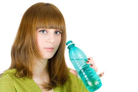 Portrait of an attractive blonde drinking water, isolated on white background photo