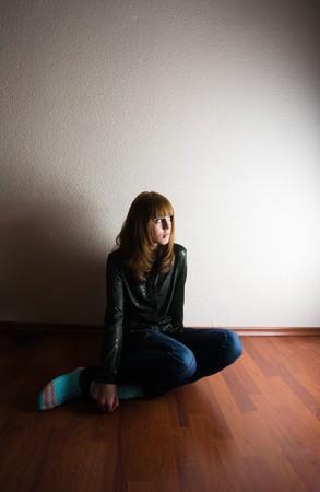Portrait of a sad teenager blonde girl photo