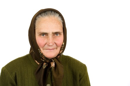 Close-up portrait of an old peasant woman isolated on white background Stock Photo - 4346614