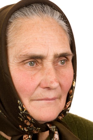 Close-up portrait of an old peasant woman isolated on white background Stock Photo - 4346722