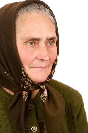 Close-up portrait of an old peasant woman isolated on white background Stock Photo - 4346705