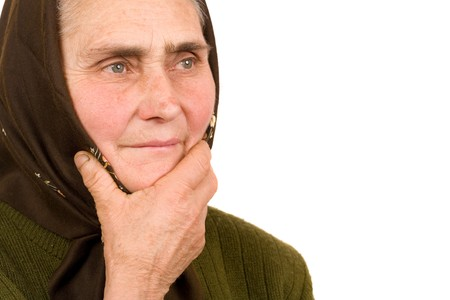 Close-up portrait of an old peasant woman isolated on white background Stock Photo - 4346627