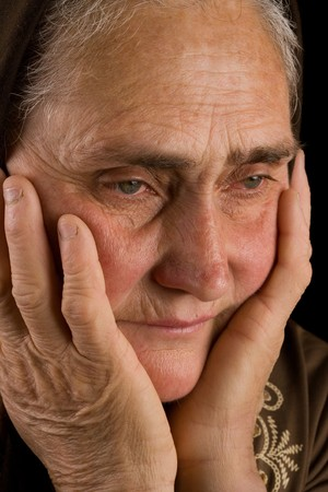 Portrait of an old woman in thoughts photo