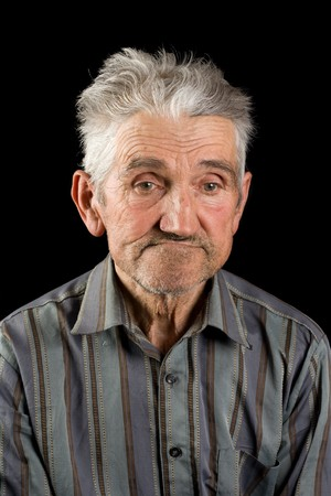 Portrait of an old man isolated on black Stock Photo - 4370927