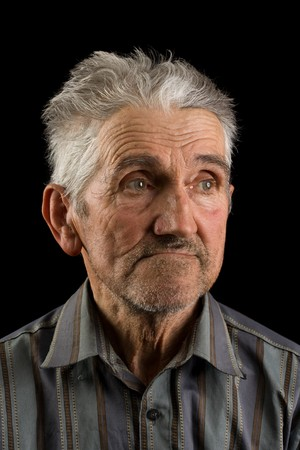 Portrait of an old man isolated on black