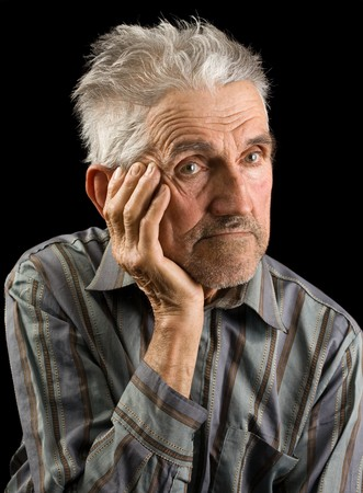 aging american: Portrait of an old man isolated on black