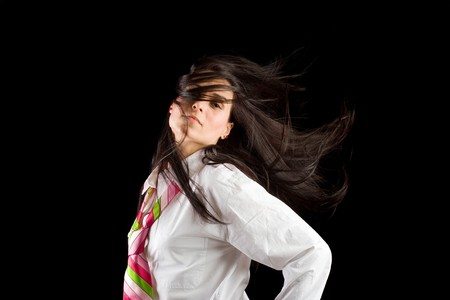 hair tie: Brunette businesswoman isolated on dark background