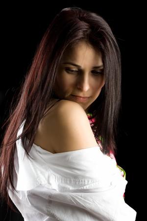 Brunette businesswoman isolated on dark background photo