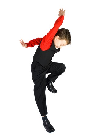 Handsome stylish little boy dancing, isolated on white background Stock Photo