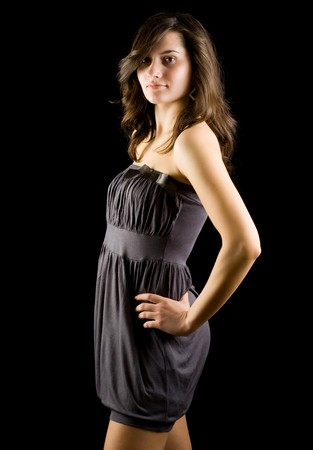 Portrait of a beautiful woman isolated on black background photo
