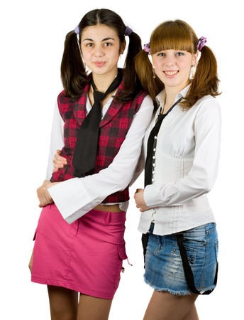 Two schoolgirls friends isolated on white background Stock Photo - 4523482