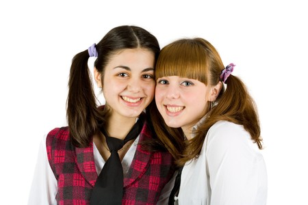 Two schoolgirls friends isolated on white background Stock Photo - 4523494