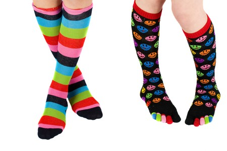 Legs of two schoolgirls with colorful stockings Stock Photo - 4523490