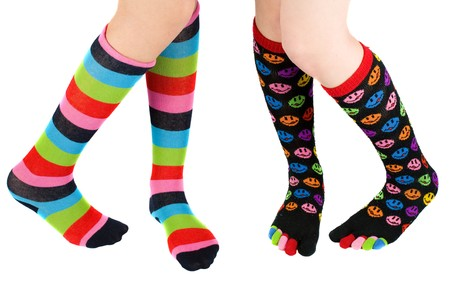 Legs of two schoolgirls with colorful stockings Stock Photo - 4523499