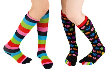 human toe: Legs of two schoolgirls with colorful stockings