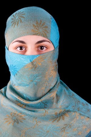 Young muslim woman isolated on black background photo