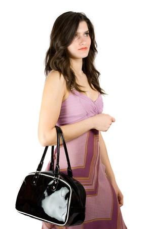 Beautiful brunette with purse isolated on white background photo