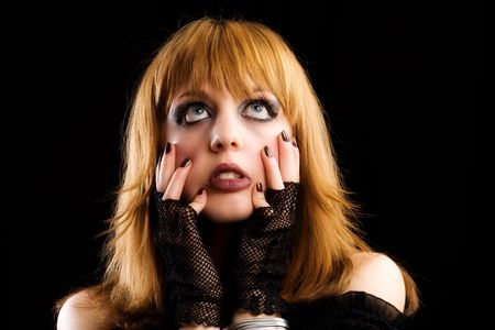Portrait of a gothic young lady isolated on dark background Stock Photo - 4819400