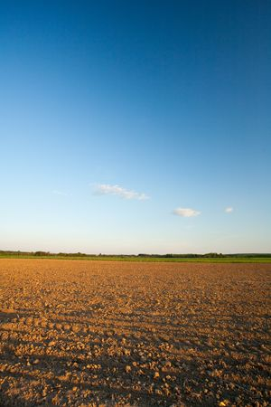 Plough soil under blue sky Stock Photo - 4834656