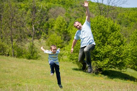Father and son having a good time together outdoor in a meadow Stock Photo - 5047488