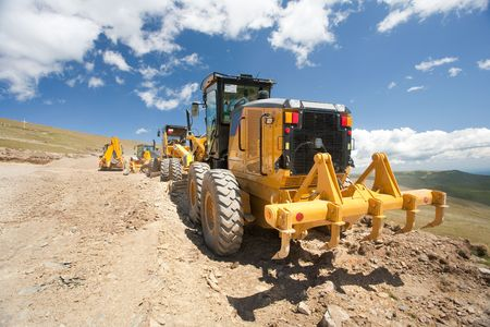 Excavators and construction machinery at a construction site outdoors Stock Photo - 5277859