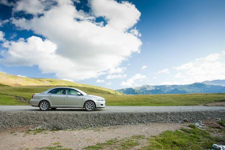 sedan: Family sedan outdoors in a remote location - holiday concept Stock Photo