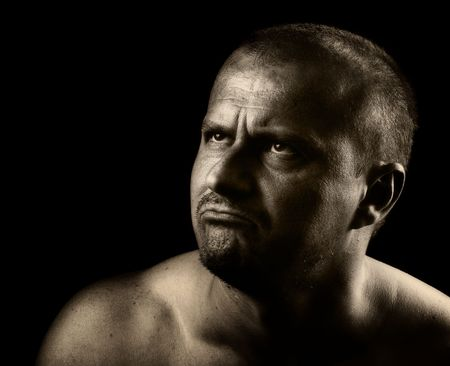High impact portrait of an angry man, isolated on black background photo